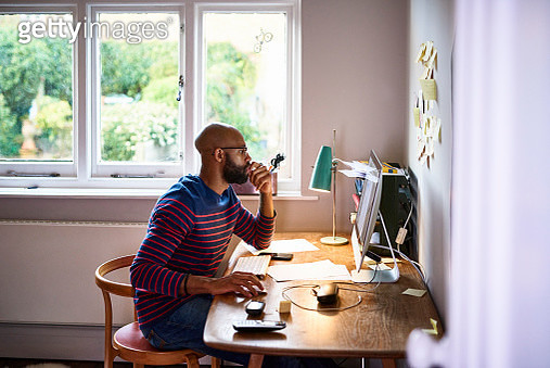 Man using computer in home office - gettyimageskorea