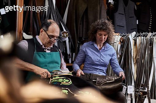 Tailor and his wife working on Bavarian lederhosen - gettyimageskorea