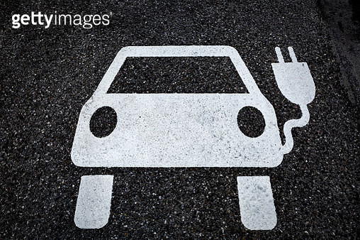 Symbol for a charging ststion for electric vehicles on tarmac - gettyimageskorea