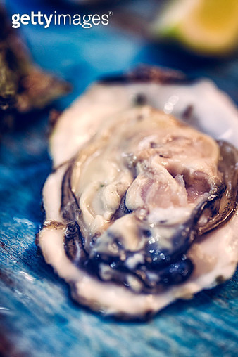 Opening Fresh Oysters - gettyimageskorea