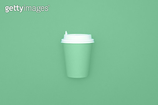 Reusable eco friendly bamboo cup for take away coffee on mint background. Space for text. Flat lay, top view. Bring your own cup concept. Zero waste, sustainable lifestyle. Mock up. - gettyimageskorea