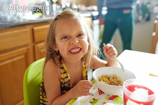 Young girl eating angrily - gettyimageskorea