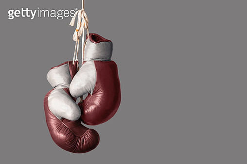 Close-Up Of Boxing Gloves Against Gray Background - gettyimageskorea
