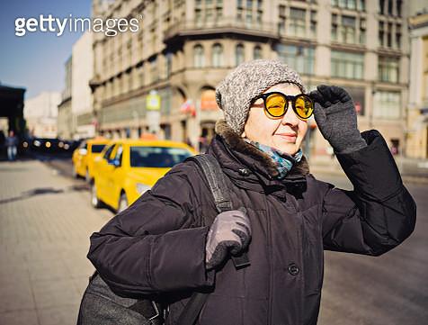 Senior tourist woman on the street - gettyimageskorea