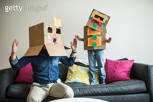Father and daughter wearing robot costumes at home - gettyimageskorea