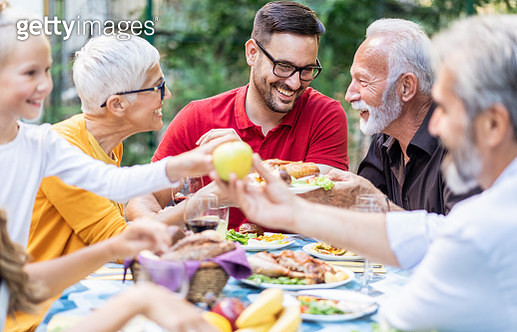 Happy big family celebrating Thanksgiving day outdoor - gettyimageskorea