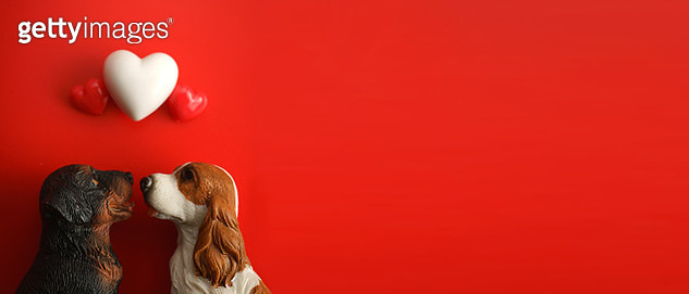 Close-Up Of Dog Figurine With Balloons Against Red Background - gettyimageskorea