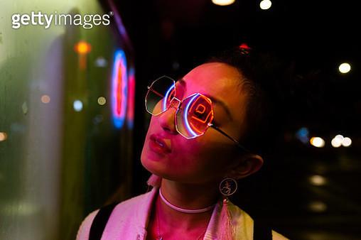 portrait of young woman under neon light - gettyimageskorea