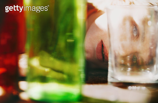 Distorted woman behind the colorful glassware - gettyimageskorea