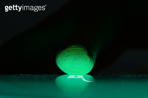 Close up photography of finger while scanning touch screen to open digital device - gettyimageskorea