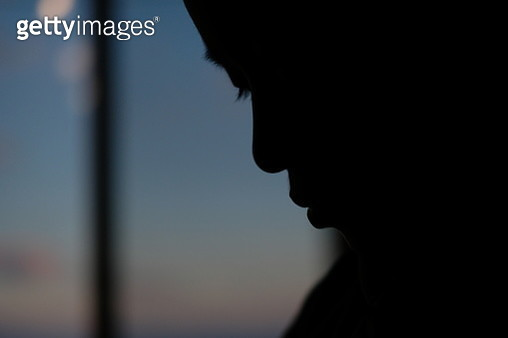 Boy's silhouette in sunset - gettyimageskorea