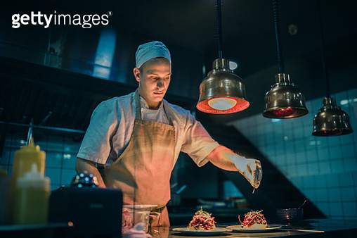 Chef cooking in the modern kitchen in a high-end restaurant - gettyimageskorea