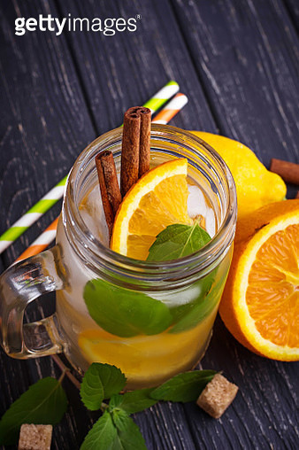 Detox Water With Orange, Mint And Cinnamon In Jar - gettyimageskorea