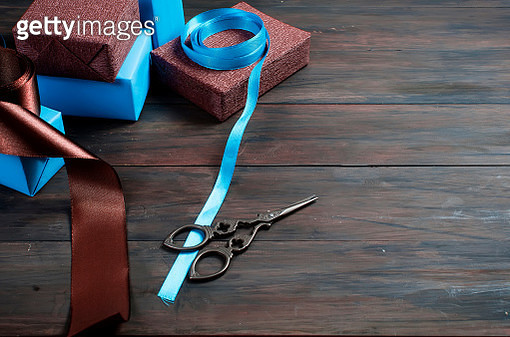 Close-Up Of Gifts With Blue Ribbons On Table - gettyimageskorea