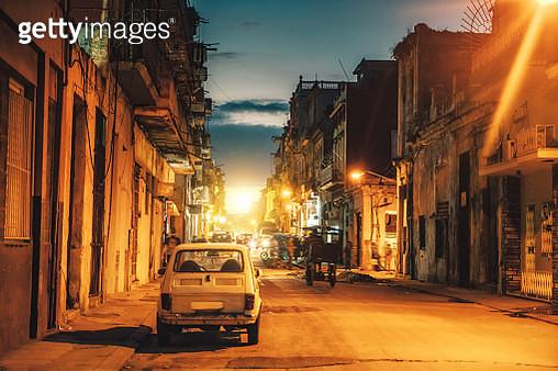 Old car on street at dusk, Havana, Cuba - gettyimageskorea