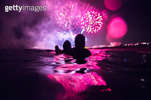 Group of girls on the Mataró festivity fireworks from inside water. - gettyimageskorea