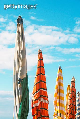 Colorful folded beach umbrellas - gettyimageskorea