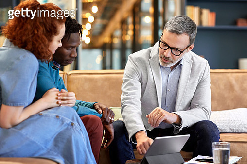 Financial advisor planning with clients at office - gettyimageskorea