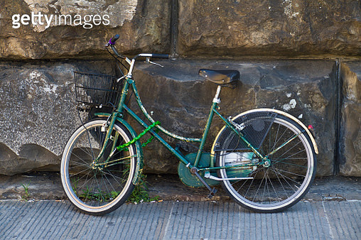 A bicycle leans agains a wall in Florence, Italy - gettyimageskorea