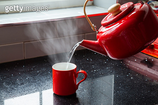 Making tea - pouring boiling water into a mug - gettyimageskorea