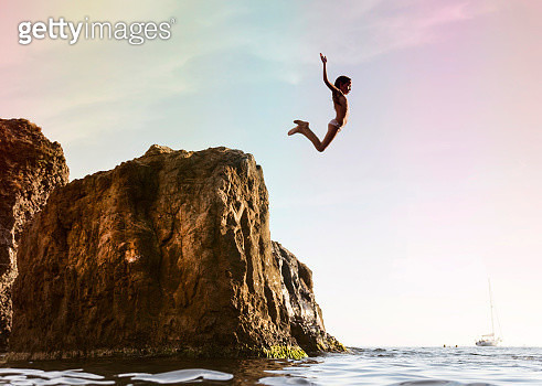 Kid diving off the cliff - gettyimageskorea