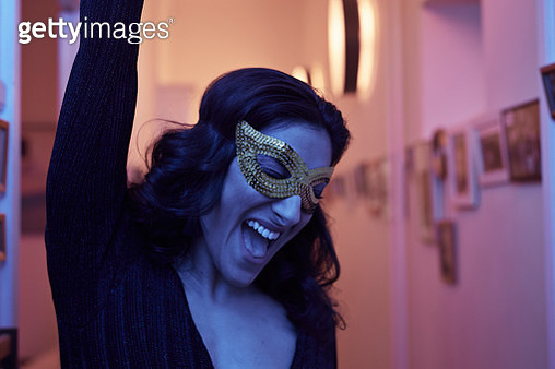 Portrait of young woman wearing mask at New Years party - gettyimageskorea