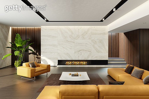Luxurious living room with natural stone, leather sofa and an eco-friendly fireplace.  Black granit eco fireplace on a natural travertine stone wall in a sitting area with a big tiles. Stylish and comfortable sitting area with a modern yellow leather sofa - gettyimageskorea