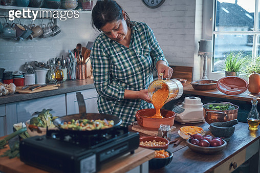 Preparing Pumpkin Stew with Chickpeas, Celery and Lentils - gettyimageskorea