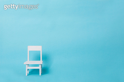Close-Up Of Small Chair Over Blue Background - gettyimageskorea