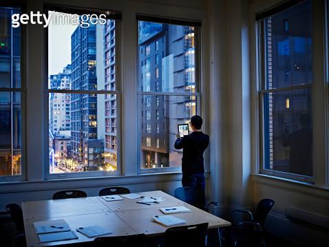 Businessman taking digital photo of cityscape - gettyimageskorea