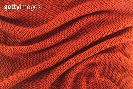 Texture of knitted red sweater folded in a swirling pattern. Flat lay style, close-up. - gettyimageskorea