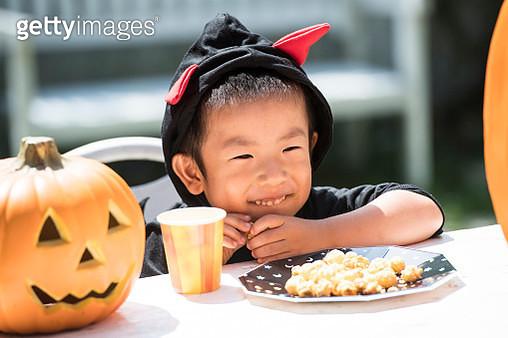 A portrait photo of a cute boy wearing a costume. - gettyimageskorea