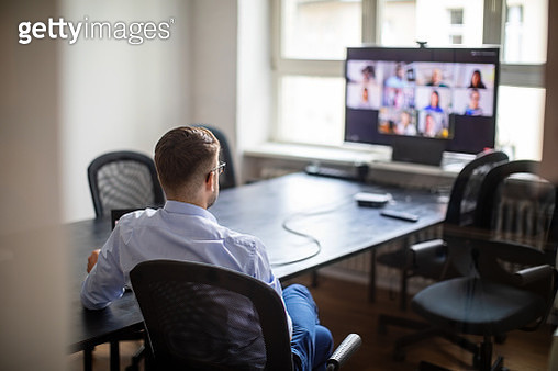 Businessman having a meeting with his team over a video call - gettyimageskorea