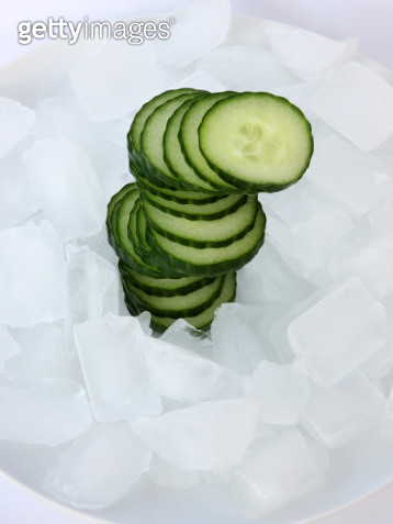 Stack of sliced cucumber with ice cubes. - gettyimageskorea