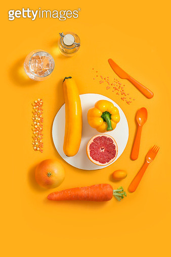 Various orange and yellow colour fruits and vegetables on purple background. - gettyimageskorea