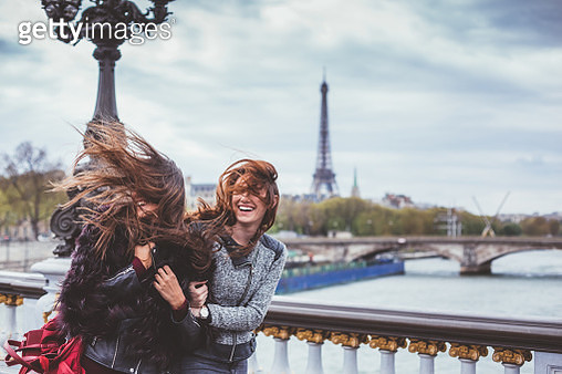 Happy friends in Paris with tousled hairs on windy day - gettyimageskorea