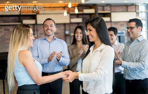 Successful women closing a deal with a handshake - gettyimageskorea