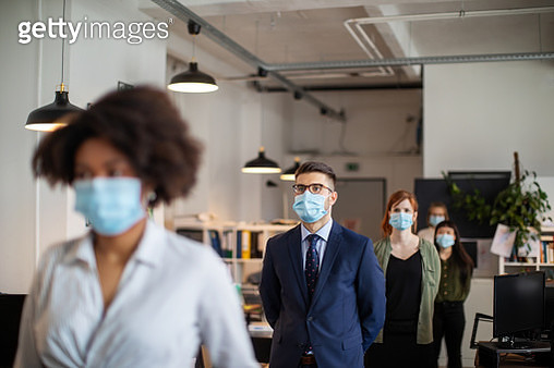 Social distancing of people waiting in the queue in office - gettyimageskorea