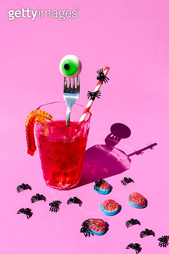 Bloody Halloween drink with eyeball, worms and spiders with blood on purple background - gettyimageskorea