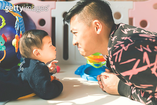 Chinese Father and son playing - gettyimageskorea