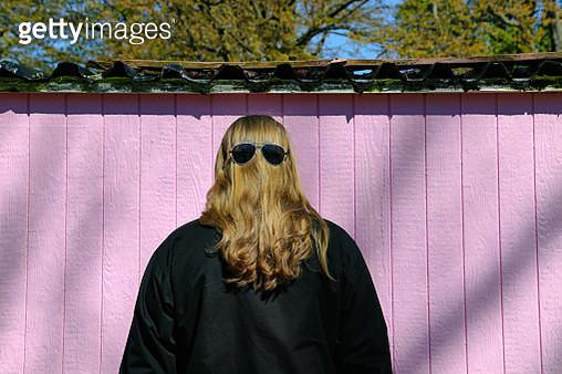 Rear View Of Woman Wearing Sunglasses On Head - gettyimageskorea