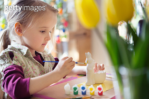 Girl (4-5) painting Easter rabbit decoration - gettyimageskorea