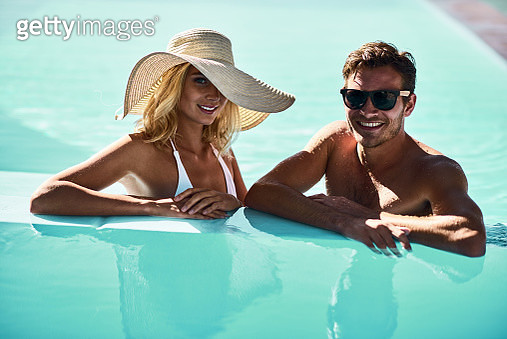 Shoot of couple having fun in a pool - gettyimageskorea