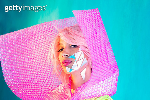 Fashion futuristic woman portrait pink hair and cyborg metal triangles on face - gettyimageskorea