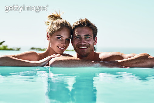 Couple having fun in a pool - gettyimageskorea