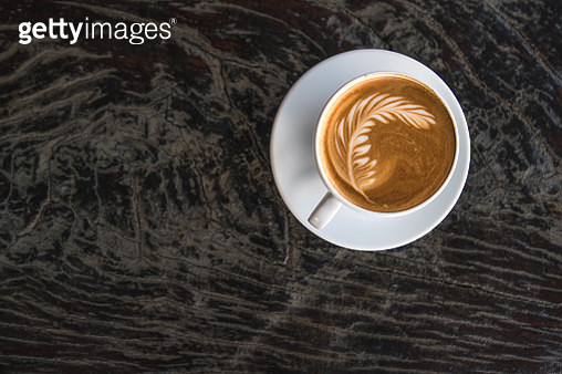cups of cappuccino with latte art on wooden background. Beautiful foam, greenery ceramic cups - gettyimageskorea