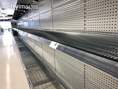Empty supermarket shelves from panic buying during the coronavirus, COVID-19 pandemic - gettyimageskorea