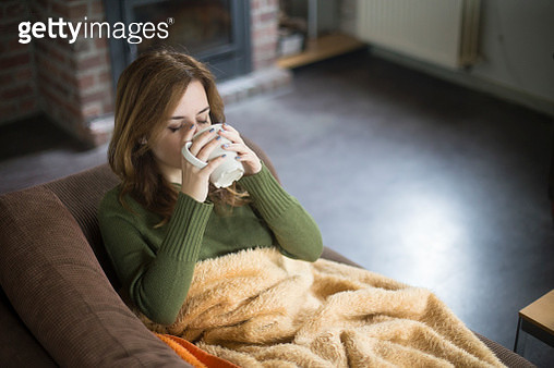 Woman having a fever - gettyimageskorea