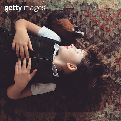 Little Girl and Her Guinea Pig - gettyimageskorea