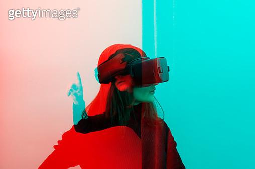 Woman wearing VR Glasses - gettyimageskorea